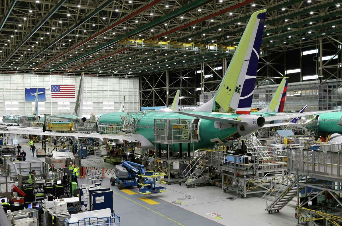 People work on the Boeing 737 MAX 8 assembly line during a brief media tour in Boeing's 737 assembly facility, Wednesday, March 27, 2019, in Renton, Wash. The Federal Aviation Administration plans to revamp oversight of airplane development after the two deadly crashes of Boeing's new 737 Max 8 airplane, according to testimony prepared for a Capitol Hill hearing on Wednesday. (AP Photo/Ted S. Warren)