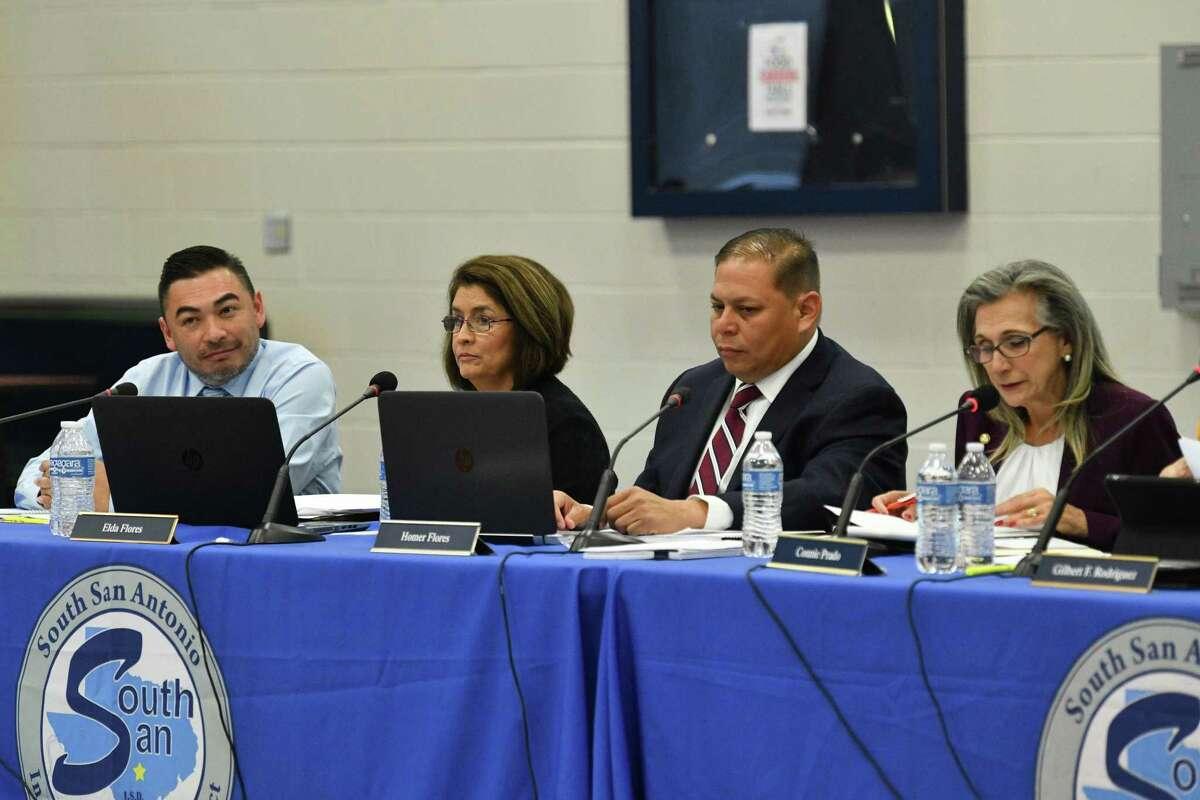 South San Antonio ISD board members Louis Ybarra Jr., left, Elda Flores, Homer Flores and Connie Prado at a meeting last March. .