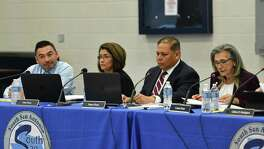 South San Antonio ISD board members Louis Ybarra Jr. , left, Elda Flores, Homer Flores and Connie Prado discuss an offer by the City of San Antonio to convert a shuttered school into a community center, which would include non profits and mental health services, during a school board meeting on Wednesday, March 27, 2019.