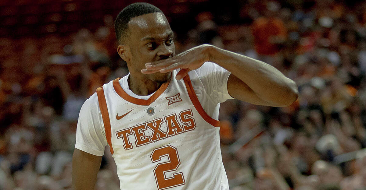 Texas guard Matt Coleman III (2) taunts the Colorado bench during an NCAA college basketball game in the quarterfinals of the NIT on Wednesday, March 27, 2019, in Austin, Texas. (Nick Wagner/Austin American-Statesman via AP)