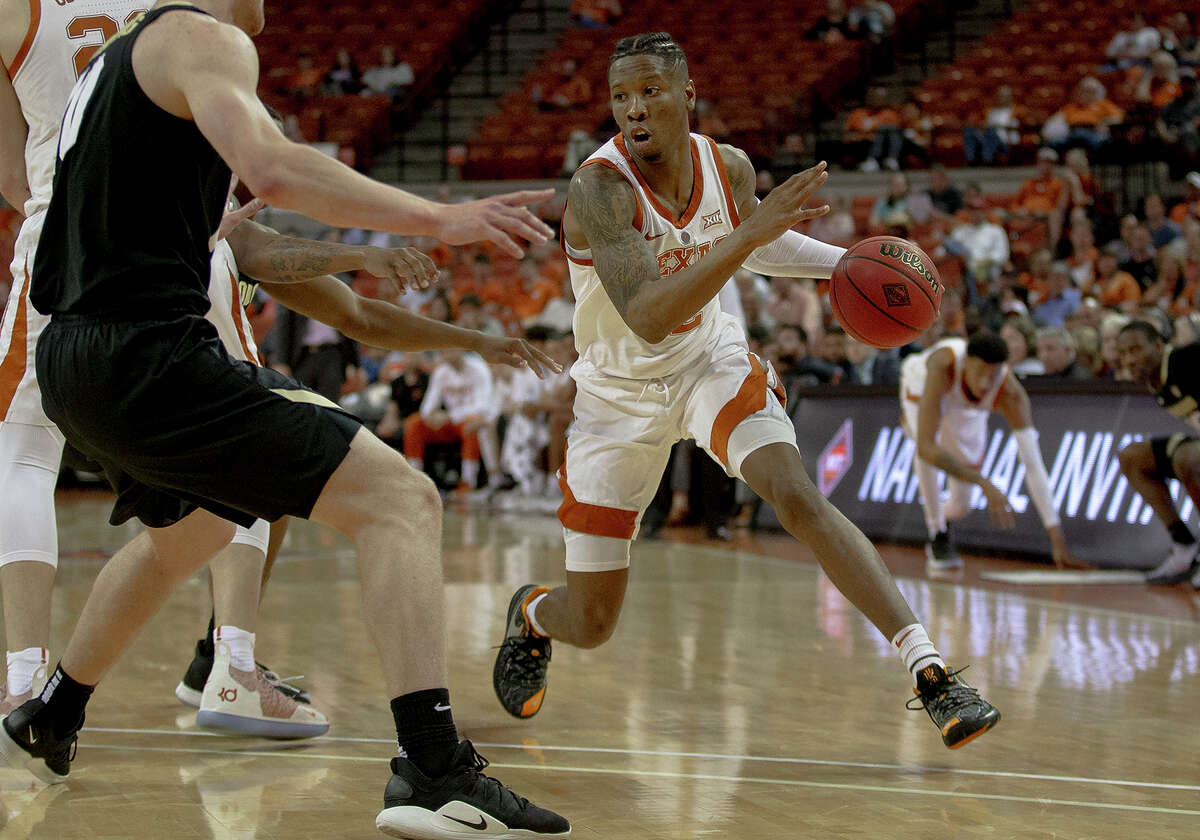 Texas guard Kerwin Roach II (12) drives against Colorado forward Alexander Strating (10) during an NCAA college basketball game in the quarterfinals of the NIT on Wednesday, March 27, 2019, in Austin, Texas. (Nick Wagner/Austin American-Statesman via AP)