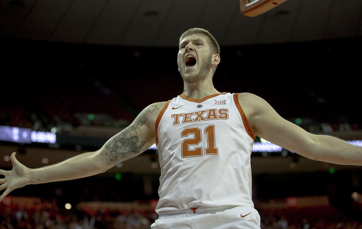 Texas forward Dylan Osetkowski celebrates his dunk against Colorado during an NCAA college basketball game in the quarterfinals of the NIT on Wednesday, March 27, 2019, in Austin, Texas. (Nick Wagner/Austin American-Statesman via AP)