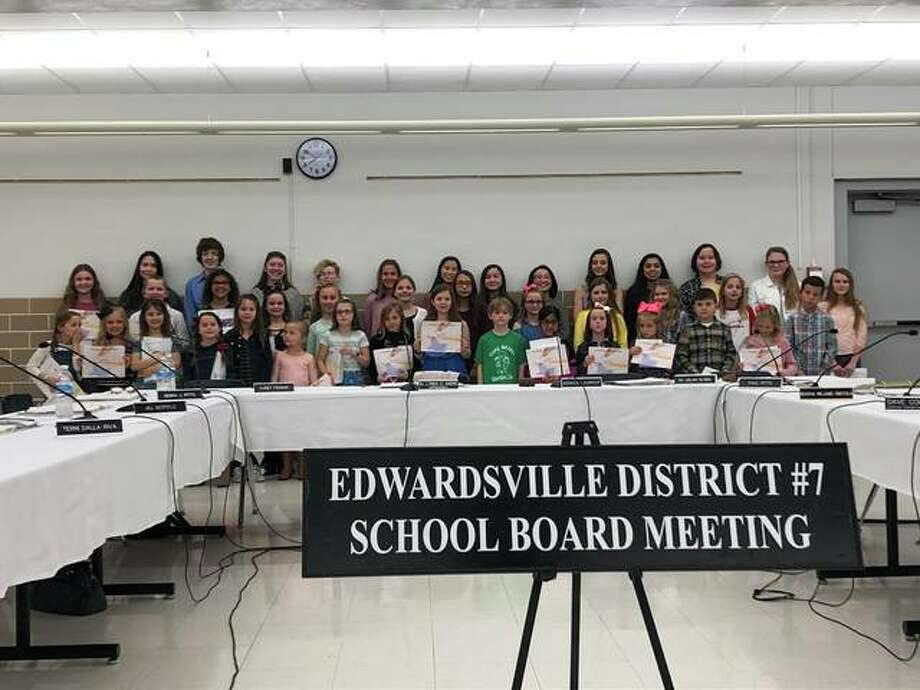 Edwardsville District 7 Board of Education recognized the district's top young authors. A total of 686 students in kindergarten through eighth grade participated in the Young Authors competition by writing and illustrating a book. Forty-eight students will compete in the Madison County competition on April 27 while 12 students will be participating in the state competition in Normal on May 18. Photo: Julia Biggs | The Intelligencer