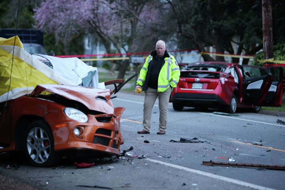 An investigator looks at the scene of a collision in which one driver was killed in the 1700 block of Sand Point Way Northeast, Wednesday, March 27, 2019. Photo: Genna Martin / seattlepi.com