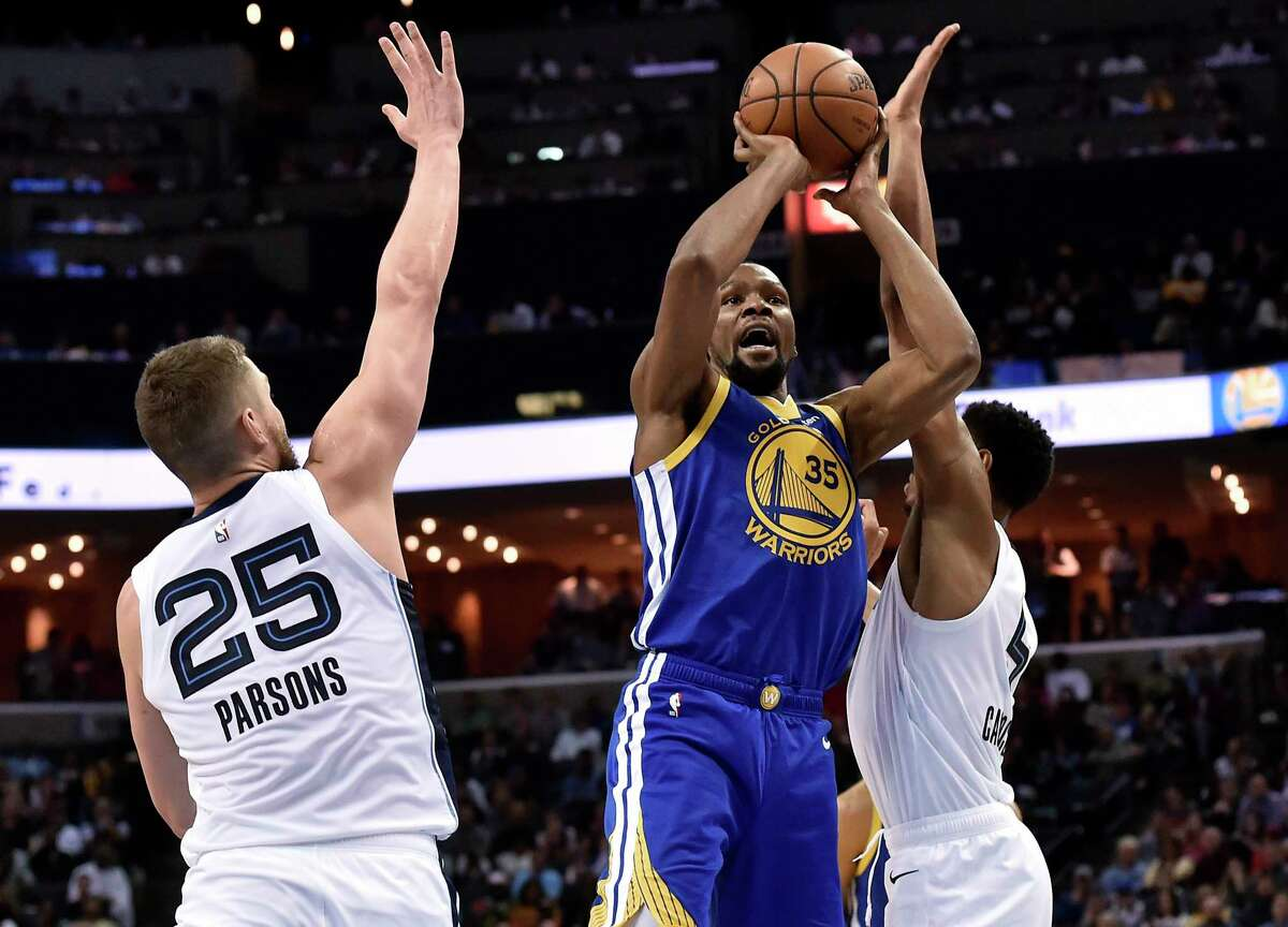 Golden State Warriors forward Kevin Durant (35) shoots between Memphis Grizzlies forwards Chandler Parsons (25) and Bruno Caboclo during the second half of an NBA basketball game Wednesday, March 27, 2019, in Memphis, Tenn. (AP Photo/Brandon Dill)