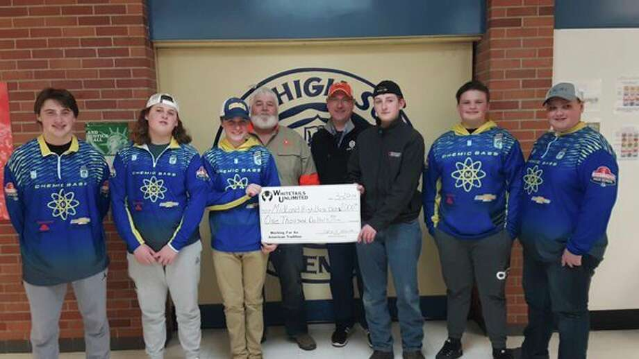 The Midland County chapter of Whitetails Unlimited recently made a $1,000 contribution to the Midland High Bass Fishing Club. Pictured, from left, are Midland High Bass Fishing Club members Jordan Warner, Alec Albrecht and Carter Albright; Midland County Whitetails Unlimited Chapter President Randy Raymond; Whitetails Unlimited Michigan Field Director Jason Maraskine; and Midland High bass fishing club members Gavin Gilmore, Logan Ware and Avery Merrow. (Dan Chalk/chalk@mdn.net)