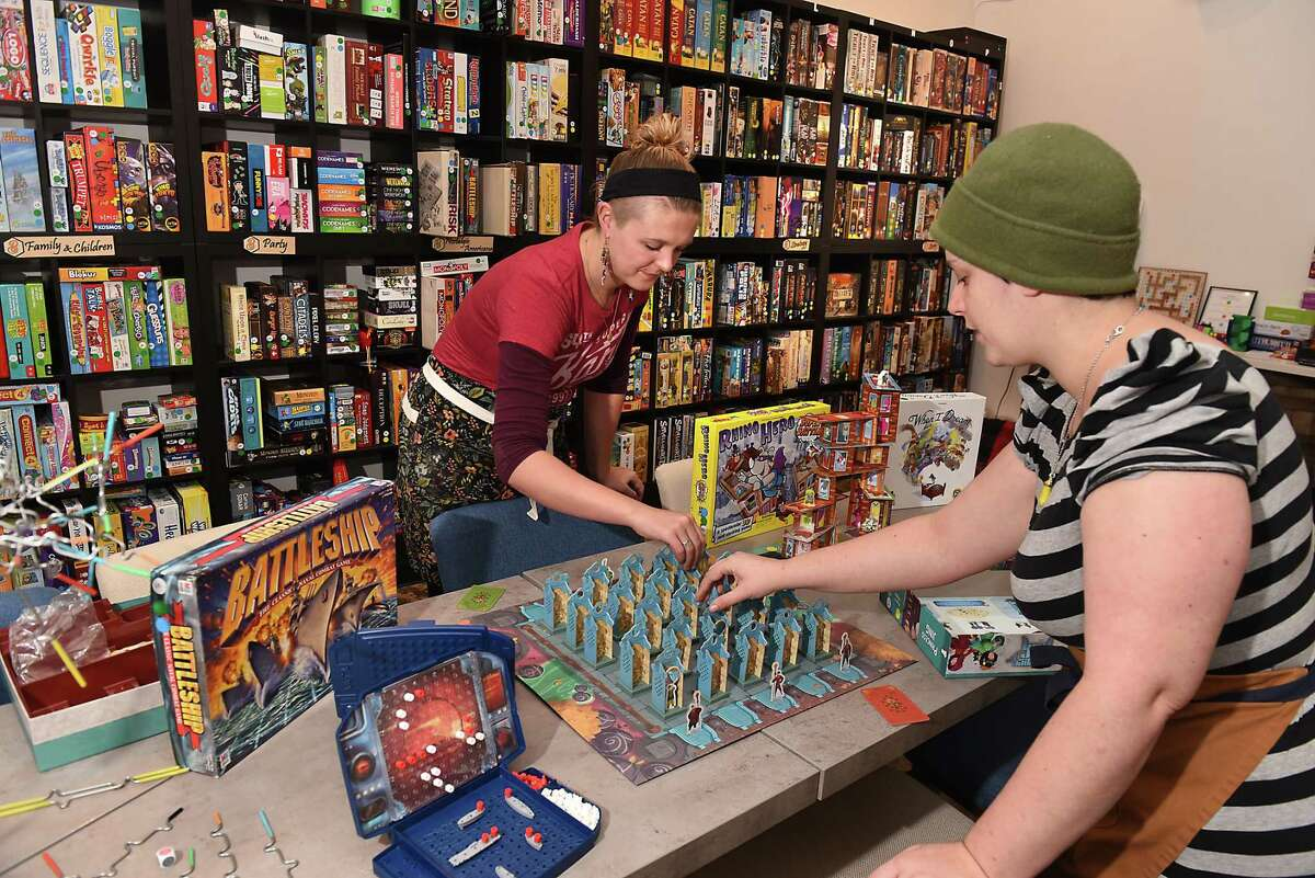 Charlotte Guyton, owner and general manager, left, helps employee Ariel Dominelli set up the board game Princess Jing at Bard and Baker on Thursday, Dec. 6, 2018 in Troy, N.Y. (Lori Van Buren/Times Union)