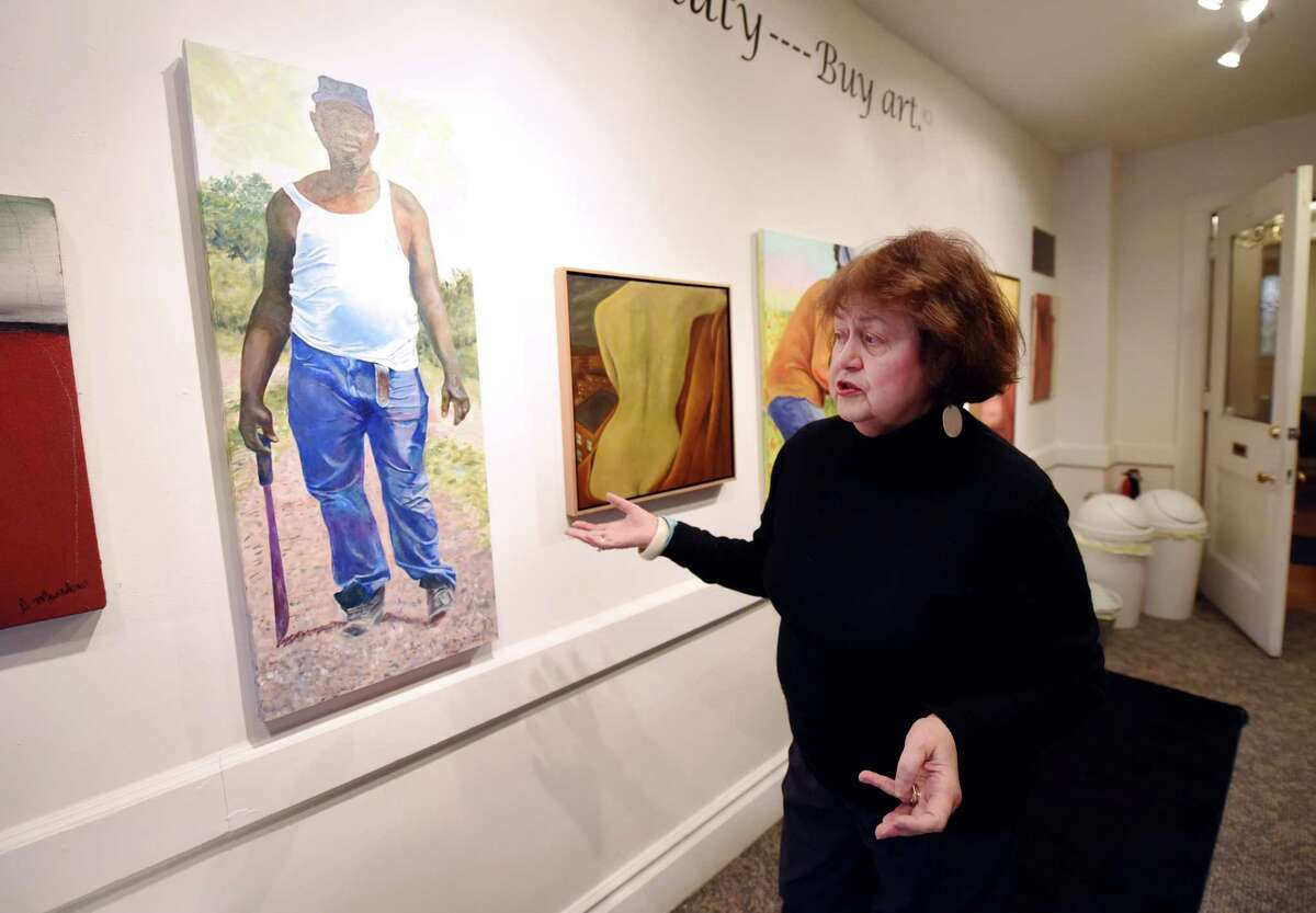 Capital Region Hispanic Chamber of Commerce President Laudelina Martinez speaks about various works of art displayed in her gallery on Thursday, Feb. 21, 2019 at the Martinez Gallery in Troy, NY. (Phoebe Sheehan/Times Union)