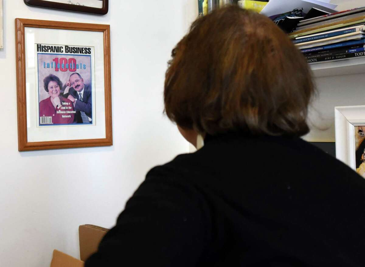 Capital Region Hispanic Chamber of Commerce President Laudelina Martinez looks at a Hispanic Business magazine cover from the 90's in which she won most influential Hispanic individual of the year on Thursday, Feb. 21, 2019 at the Martinez Gallery in Troy, NY. (Phoebe Sheehan/Times Union)
