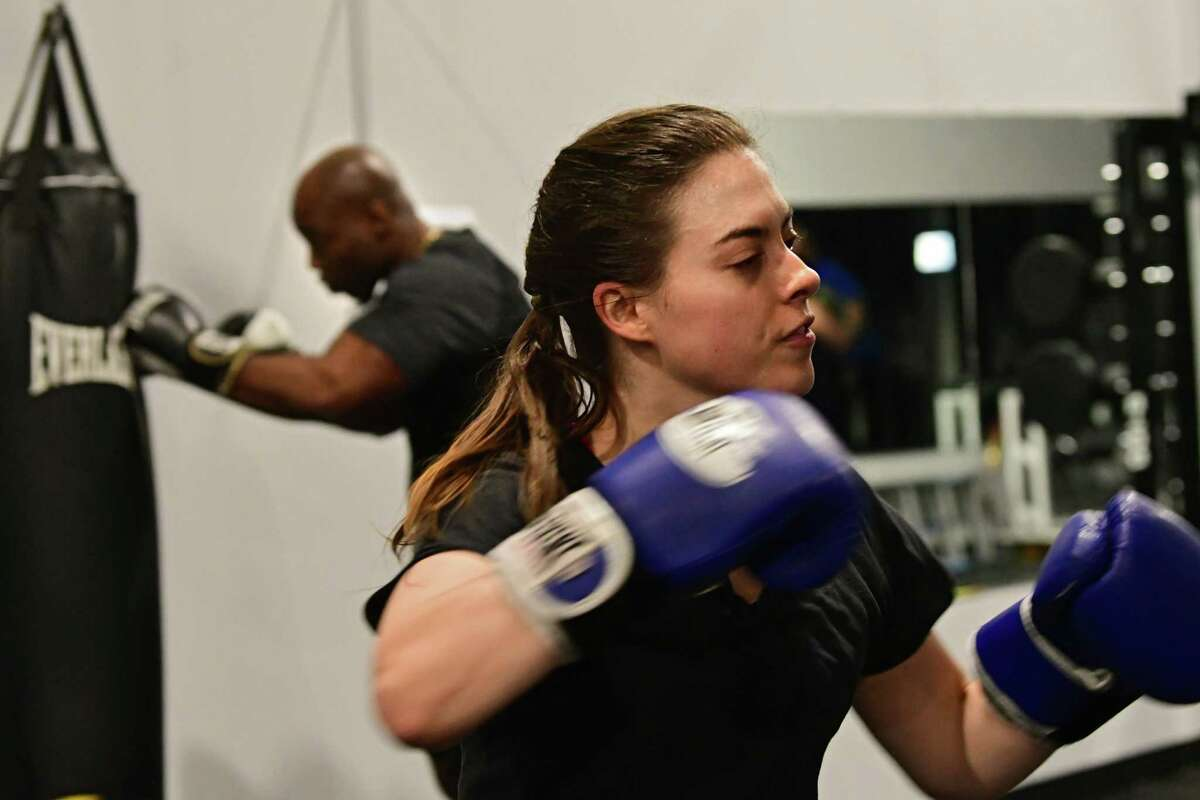 Times Union writer Sara Tracey takes a boxing/HIIT class lead by Rick Angerami at PIT Fitness on Thursday, Feb. 28, 2019 in Colonie, N.Y. Rick runs Cap City Fitness. (Lori Van Buren/Times Union)