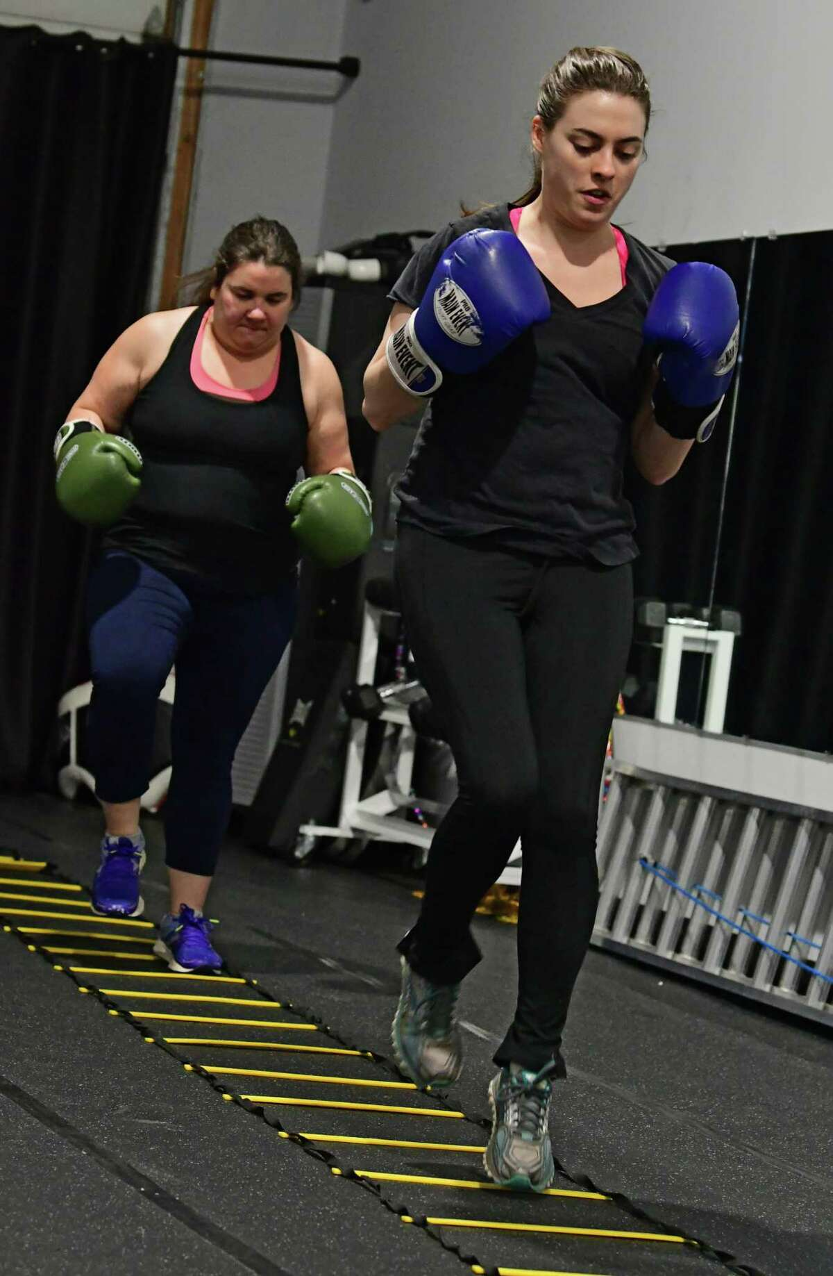Times Union writer Sara Tracey, right, takes a boxing/HIIT class lead by Rick Angerami at PIT Fitness on Thursday, Feb. 28, 2019 in Colonie, N.Y. Rick runs Cap City Fitness. (Lori Van Buren/Times Union)