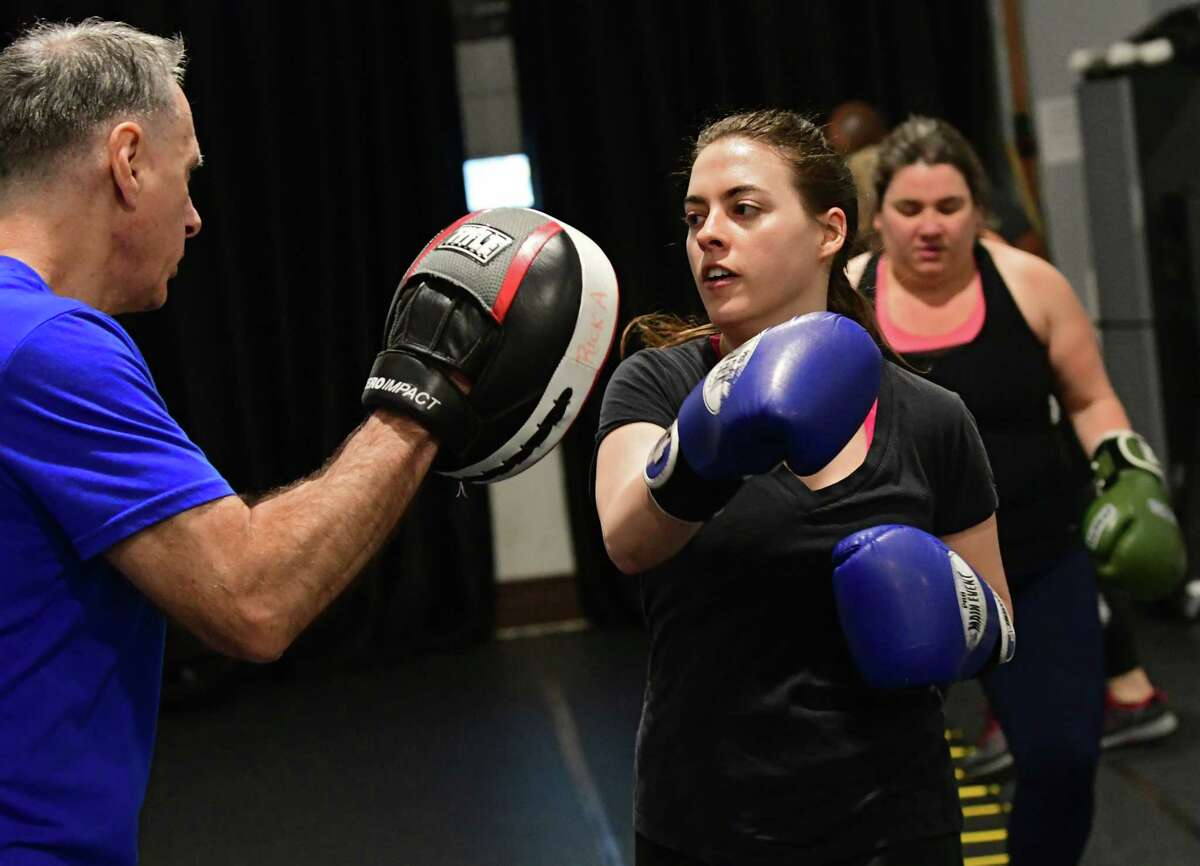 Times Union writer Sara Tracey takes a boxing/HIIT class with Rick Angerami, left, at PIT Fitness on Thursday, Feb. 28, 2019 in Colonie, N.Y. Rick runs Cap City Fitness. (Lori Van Buren/Times Union)