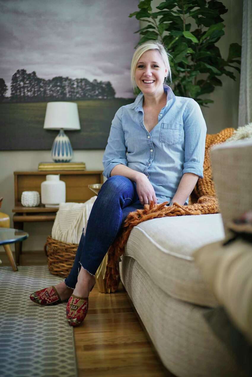 Designer Lee Owens poses for a photo in her living room on Tuesday, March 5, 2019, in Niskayuna, N.Y. (Paul Buckowski/Times Union)