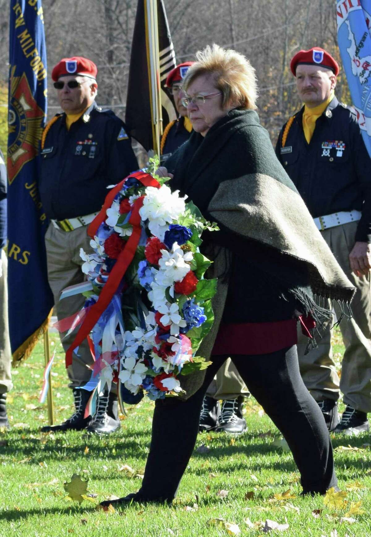 The Roger Sherman Chapter, Daughters of the American Revolution, which will hold a special program at Harrybrooke Park in New Milford April 6, supports programs for veterans and children, promotes historic preservation and provides educational opportunities. Above, chapter regent Bonnie Butler presents a wreath on Veterans Day 2018.
