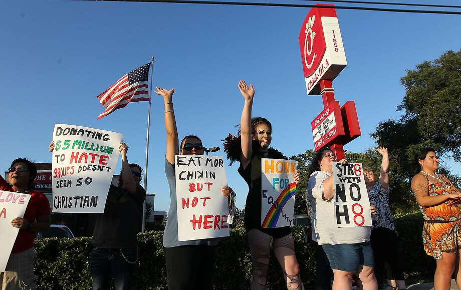Activists and supporters demonstrate in front of the Chick-fil-A restaurant in 2012. Photo: Kin Man Hui, San Antonio Express-News
