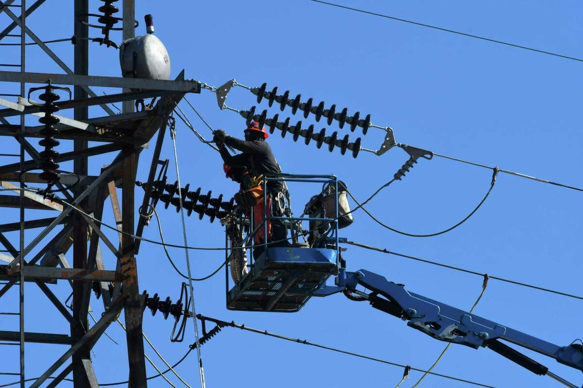 Linemen with National Grid replace insulators on a power line at the South Bay Boat Launch on the shores of Lake Champlain on Tuesday, March 26, 2019, in Whitehall, N.Y. National Grid is adding osprey nest platforms to the top of towers in the North Country. Nesting birds have caused power outages in the area. Nest relocation efforts are focused in the areas of Whitehall, Hague and Port Henry. (Will Waldron / Times Union)