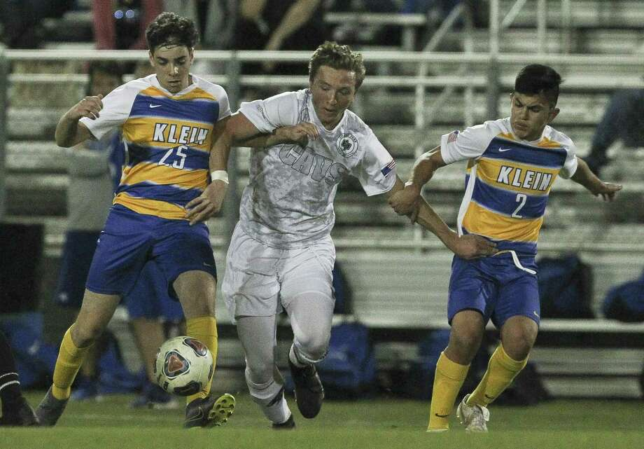 College Park midfielder James Ross-Kirov (8) fights for a ball between Klein midfielders Carlos Casolari (25) and Sammy Narvaez (2) during the first period of a District 15-6A high school soccer match at Klein High School, Friday, March 22, 2019, in Spring. Photo: Jason Fochtman, Houston Chronicle / Staff Photographer / © 2019 Houston Chronicle