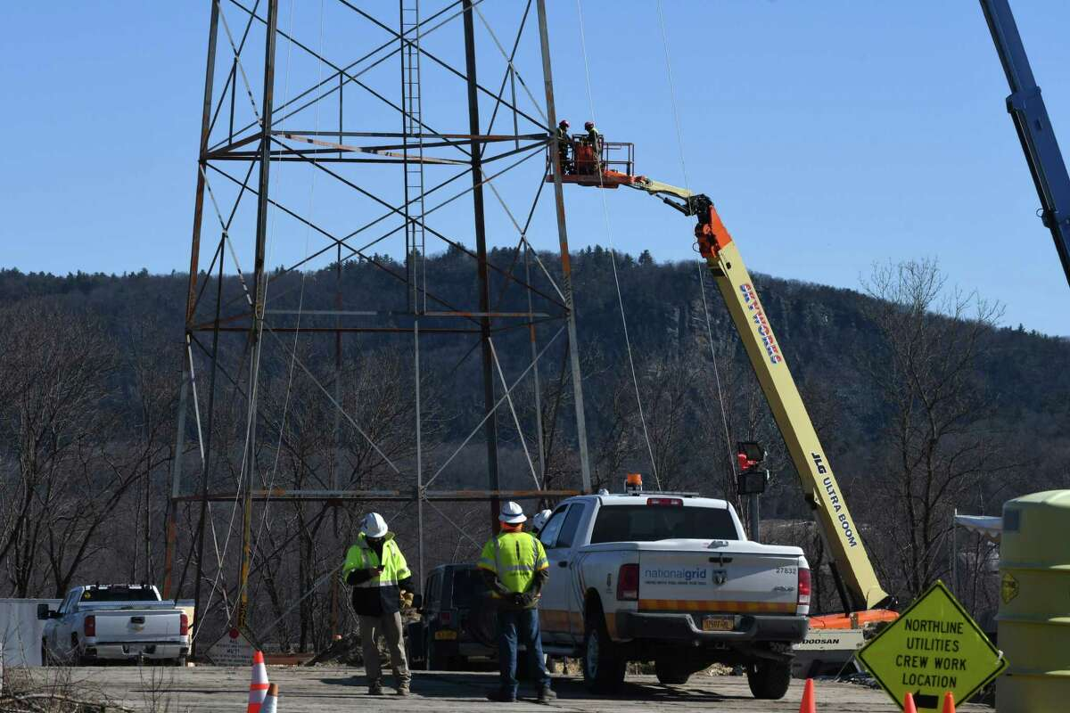 Linemen with National Grid perform work on a power line at the South Bay Boat Launch on the shores of Lake Champlain on Tuesday, March 26, 2019, in Whitehall, N.Y. National Grid is adding osprey nest platforms to the top of towers in the North Country. Nesting birds have caused power outages in the area. Nest relocation efforts are focused in the areas of Whitehall, Hague and Port Henry. (Will Waldron / Times Union)