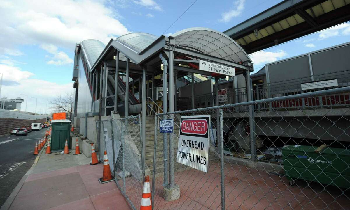 The construction of an escalator, photograph on Tuesday, March 19, 2019, to Track 5 at Stamford Station has dragged on for years, and according to the state DOT, the budget for the project is now over $1 million more than the original contract. The main culprit is bringing the building up to code. The work apparently brought up a number of issues that needed to be addressed in terms of the building code. The escalator is on the north side of the station, by the highway in Stamford, Connecticut.