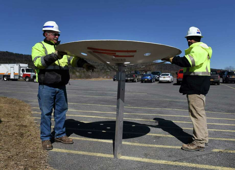 Workers with National Grid hold one of the osprey nesting platforms that will be added to utility towers. The work was completed the last week in March in Whitehall, just in time for New York's osprey season, which starts April 1. Nest relocation efforts are focused in the areas of Whitehall, Hague and Port Henry. (Will Waldron / Times Union) / 40046522A