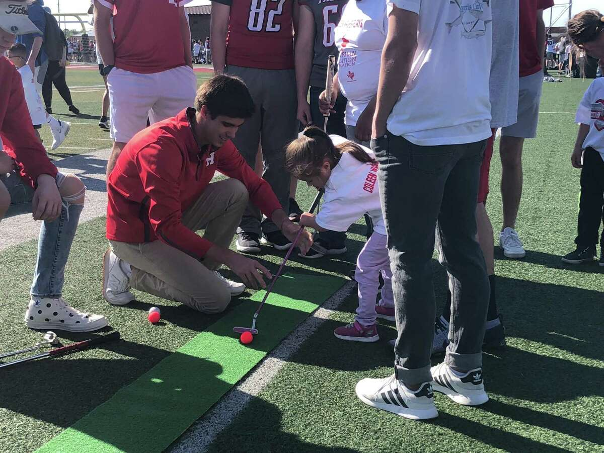 Members of the Hargrave golf team run a putting activity at the 2019 Coleen Walker Relays at Falcon Stadium in Huffman on the morning of March 27