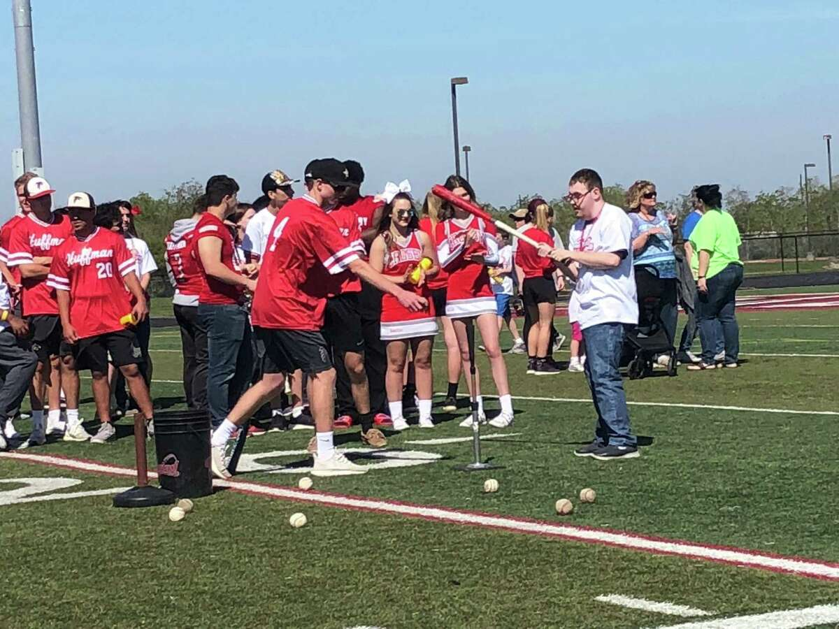 Members of the Hargrave baseball team run a tee ball activity at the 2019 Coleen Walker Relays at Falcon Stadium in Huffman on the morning of March 27