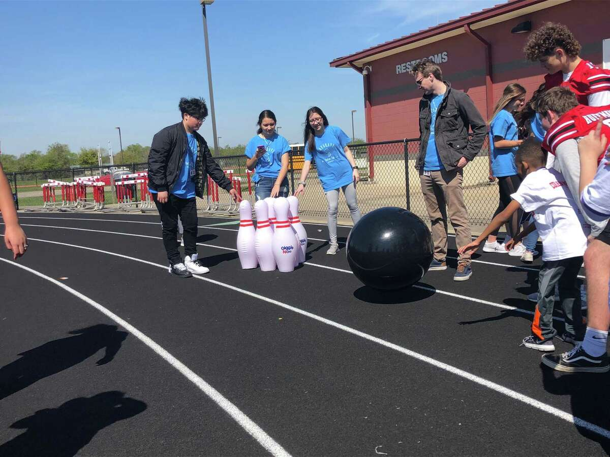 Members of the Hargrave Italian Club run a bowling activity at the 2019 Coleen Walker Relays at Falcon Stadium in Huffman on the morning of March 27