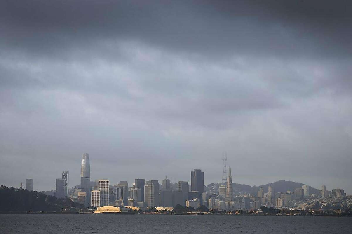 Dark clouds hover above San Francisco, Calif. as the Bay Area begins to dry out on Thursday, March 28, 2019.
