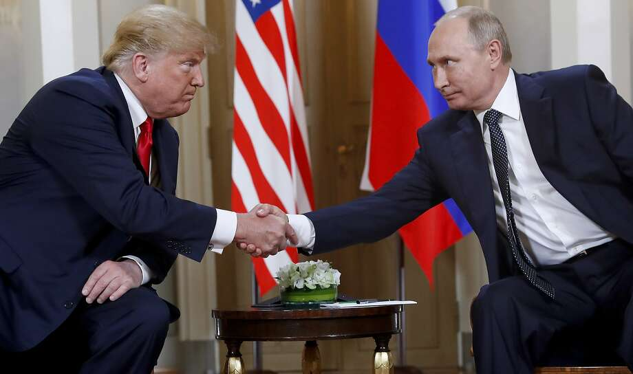FILE In this file photo taken on Monday, July 16, 2018, U.S. President Donald Trump, left, and Russian President Vladimir Putin shake hands at the beginning of a meeting at the Presidential Palace in Helsinki, Finland.  U.S. special counsel Robert Mueller has yet to release his report about Russian meddling in the 2016 U.S. presidential election, but Moscow has already rehearsed its response, dismissing Mueller's investigation as part of the U.S. political infighting. (AP Photo/Pablo Martinez Monsivais, File) Photo: Pablo Martinez Monsivais, Associated Press