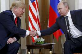FILE In this file photo taken on Monday, July 16, 2018, U.S. President Donald Trump, left, and Russian President Vladimir Putin shake hands at the beginning of a meeting at the Presidential Palace in Helsinki, Finland. U.S. special counsel Robert Mueller has yet to release his report about Russian meddling in the 2016 U.S. presidential election, but Moscow has already rehearsed its response, dismissing Mueller's investigation as part of the U.S. political infighting. (AP Photo/Pablo Martinez Monsivais, File)