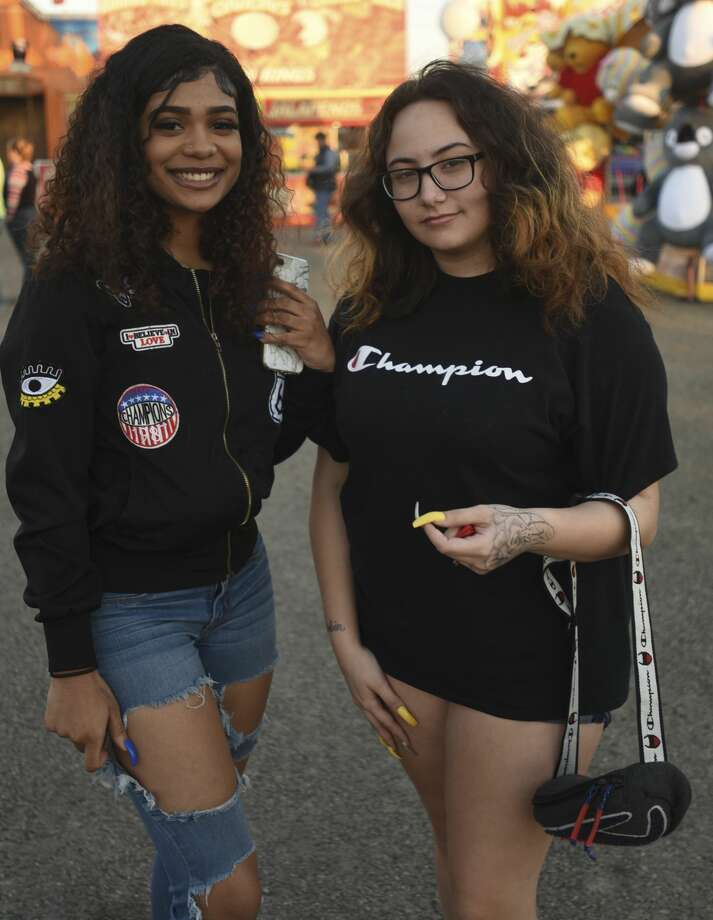 Nevaeh Owens and Esmeralda Estrada pose for a photo at the South Texas State Fair on Wednesday afternoon. Photo taken on Wednesday, 03/27/19. Ryan Welch/The Enterprise Photo: Ryan Welch/The Enterprise