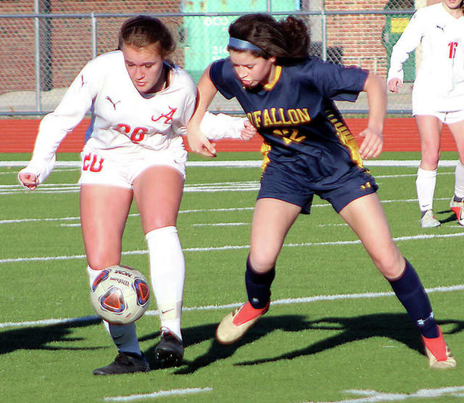 Sydney Brunaugh, left, had an assist in Alton High;'s 3-2 loss at Belleville Althoff Wednesday night. She is shown in action against O'Fallon earlier this season. Photo: Pete Hayes | The Telegraph