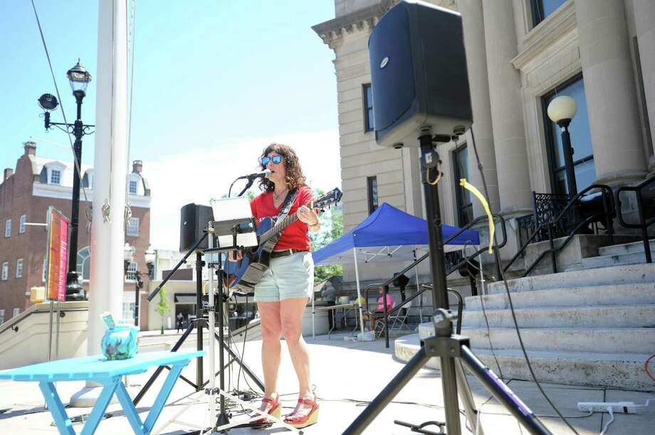 Musician nelson AKA Julia Maimon performs in front of Old Town Hall during the Make Music Day event in downtown Stamford in 2018. Musicians are being sought for this year's edition, which takes place Friday, June 21. Photo: Hearst Connecticut Media File Photo / Stamford Advocate