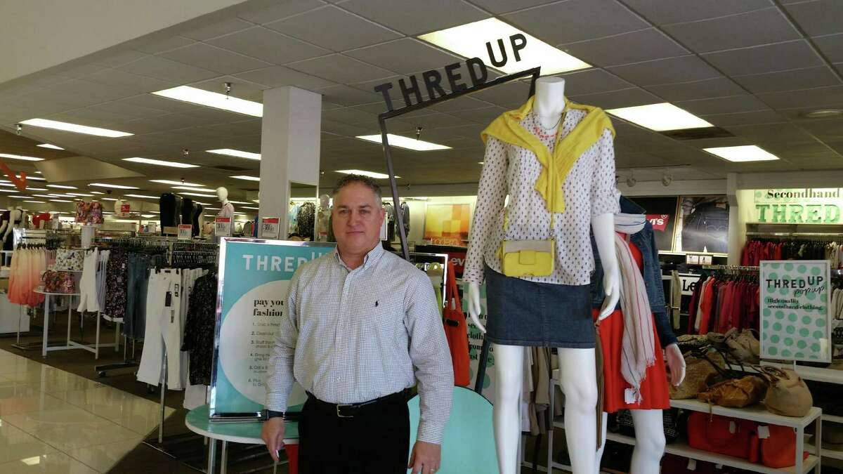 William McLeod, store manager of the Tomball location of Palais Royal at 27714 Texas 249 stands by the thredUP section inside the store. The store one of six locations in the Houston area to team up with thredUP, an online consignment store.