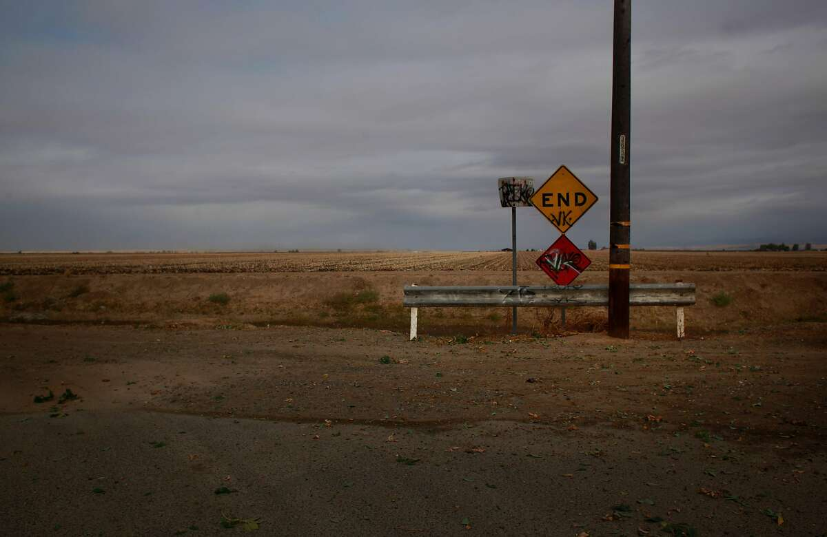 A dead end road meets vast agricultural fields in the town of Planada in Merced County, Calif. on Monday Oct. 22, 2012. Merced County in California's central Valley is one of the hardest hit communities when it comes to the nations unemployment and foreclosed crisis.
