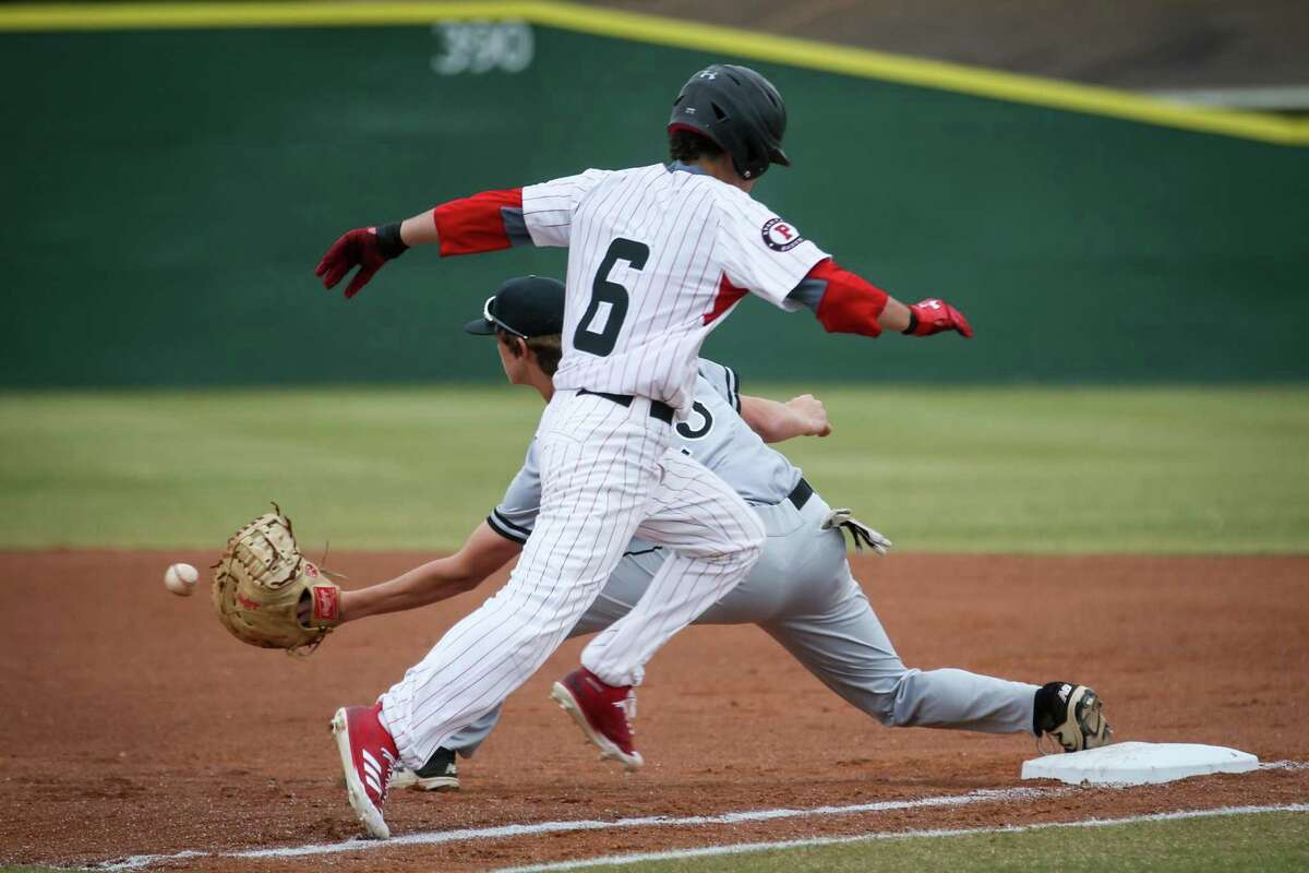 Kingwood Park's Parker Roberts (13) catches the ball as Porter's Tayler Baker (6) sprints for first base during the baseball game on Saturday, March 24, 2018, at Porter High School. (Michael Minasi / Houston Chronicle)