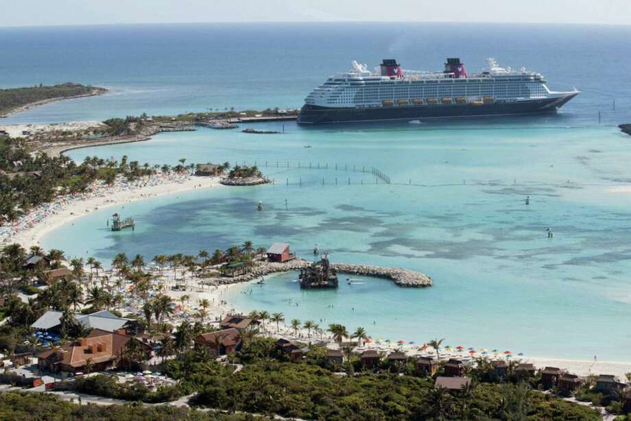 This undated photo shows a Disney Cruise Line ship docked at Castaway Cay, Disney's private island in the Bahamas. Photo: Walt Disney Co. / TNS / Walt Disney Co.