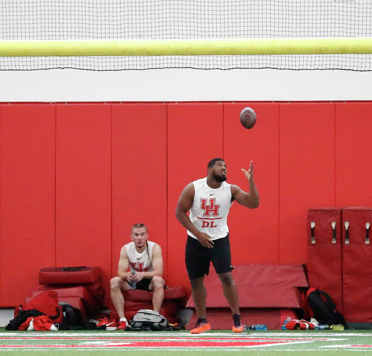 Ed Oliver dunks a football over the goal post between drills at the University of Houston Pro Day at UH's Indoor Practice Facility, Thursday, March 28, 2019, in Houston.
