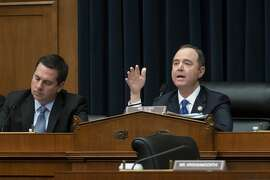 """House Intelligence Committee Chairman Adam Schiff, D-Calif., joined at left by Rep. Devin Nunes, R-Calif, the ranking member, asks questions of witnesses as the Democrat-controlled panel pushed ahead with their oversight of the Trump administration at a hearing to examine to examine """"Putin's Playbook,"""" how the Russian government works to undermine its adversaries, especially the U.S., on Capitol Hill in Washington, Thursday, March 28, 2019. (AP Photo/J. Scott Applewhite)"""