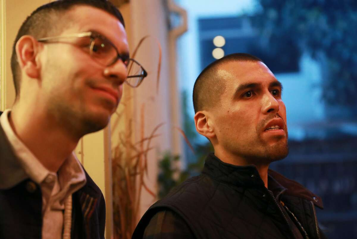 Louis Trevino (left) and Vincent Medina listen as Alicia Potts-Adams shares a story at the Cafe Ohlone pop-up at 2430 Bancroft Way in Berkeley, Calif., on Saturday, March 23, 2019.