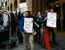 (l-r) Lyft drivers Muaad Almaliki, and Aaron S. (right) protest against Lyft's paycuts and company's announcement to go public outside the Omni Hotel in San Francisco , California, on Monday, March 25, 2019. A rush of IPOs has San Francisco worried about how many new millionaires will be affecting the city, but there are several economic cross-currents that will complicate that narrative.