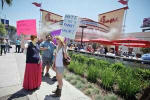 HOLLYWOOD, CA - AUGUST 01: (L-R) Jane Wison and actress Kris McGaha attend the 'Chick-Fil-A Is Anti-Gay!' PETA and LGBT community protest at Chick-fil-A on August 1, 2012 in Hollywood, California. (Photo by Tibrina Hobson/FilmMagic)