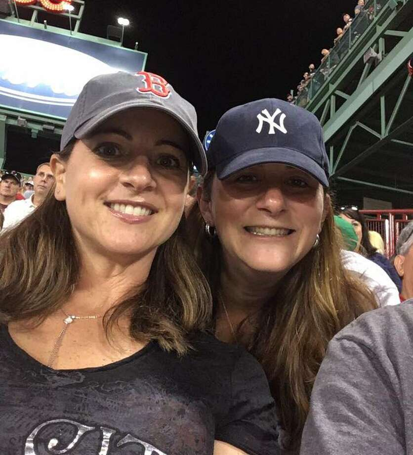 State Rep. Christie Carpino, R-Cromwell, is shown at Fenway Park with a friend during a Red Sox/Yankees game. Photo: Contributed Photo