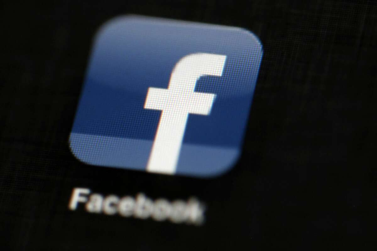 FILE - In this May 16, 2012, file photo, the Facebook logo is displayed on an iPad in Philadelphia. Facebook was charged with discrimination by the U.S. Department of Housing and Urban Development because of its ad-targeting system. (AP Photo/Matt Rourke, File)