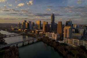 FILE - This Feb. 7, 2018, file photo shows the skyline in Austin, Texas. Amazon on Thursday, March 28, 2019, announced expansion of its Austin tech hub. A company statement says the new jobs will include software and hardware engineering, research science and cloud computing. Seattle-based Amazon currently employs more than 20,000 workers across the company's 17 North American tech hubs. More than 1,000 jobs have been created in the Austin tech hub in the last four years.(Jay Janner/Austin American-Statesman via AP, File)