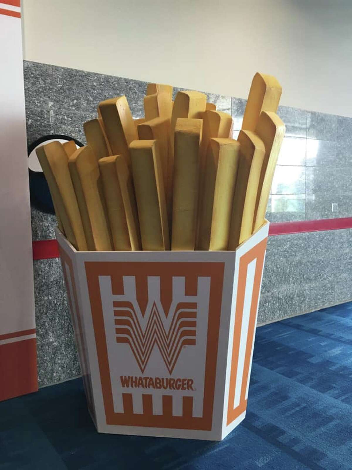 """Over-sized fries and Fancy Ketchup packets can be found in the convention center. According to a Whataburger spokesperson, attendees experience the brand in a """"larger-than-life"""" setting in order to celebrate the pride they have for their hometowns."""