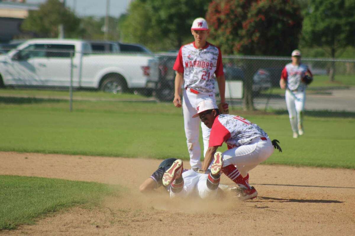 FBCA's Manny Martinez tags out Bay Area Christian's Mavrick Martinez at second base in the opening inning of their district game Tuesday. Looking on is shortstop Caleb Walker.
