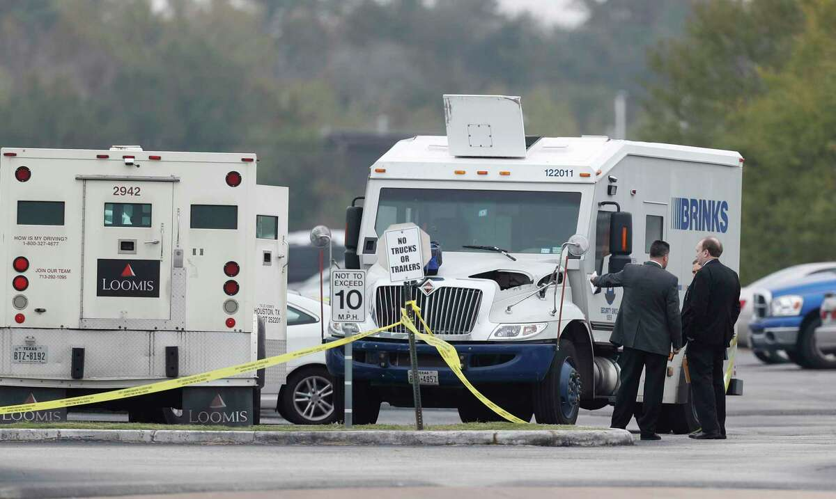 Houston Police detectives work the scene at 16250 Imperial Valley Drive, after a robbery suspect was shot by officers, Wednesday,Dec. 7, 2016 in Houston. After a series of recent violent armored car robberies, HPD conducted an under cover operation that included the use of an armored Brinks truck. ( Karen Warren / Houston Chronicle )