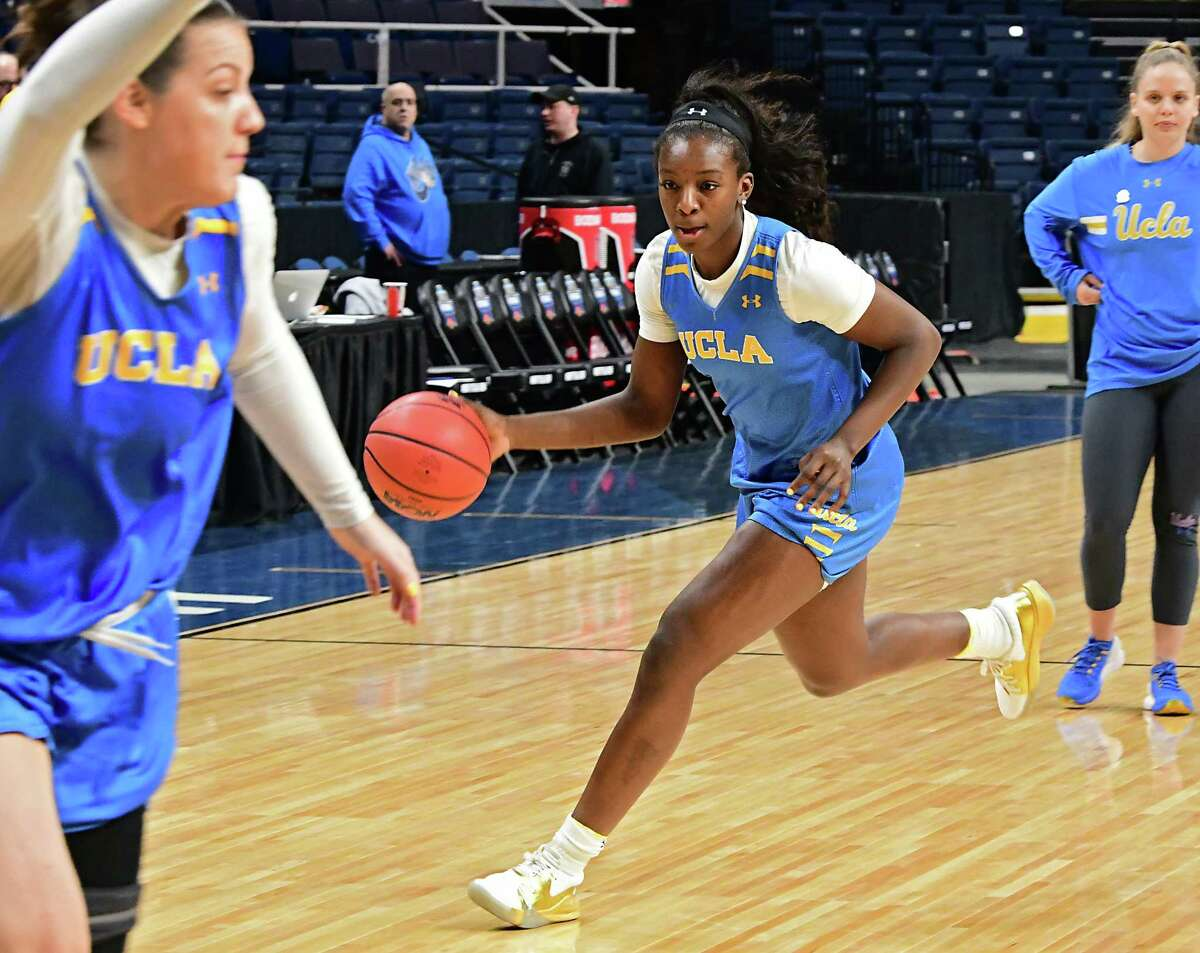 UCLA's Michaela Onyenwere dribbles the ball during practice the day before the Albany Regional of the NCAA Women's Basketball Championship at the Times Union Center on Thursday, March 28, 2019 in Albany, N.Y. UCLA will be taking on University of Connecticut on Friday. (Lori Van Buren/Times Union)