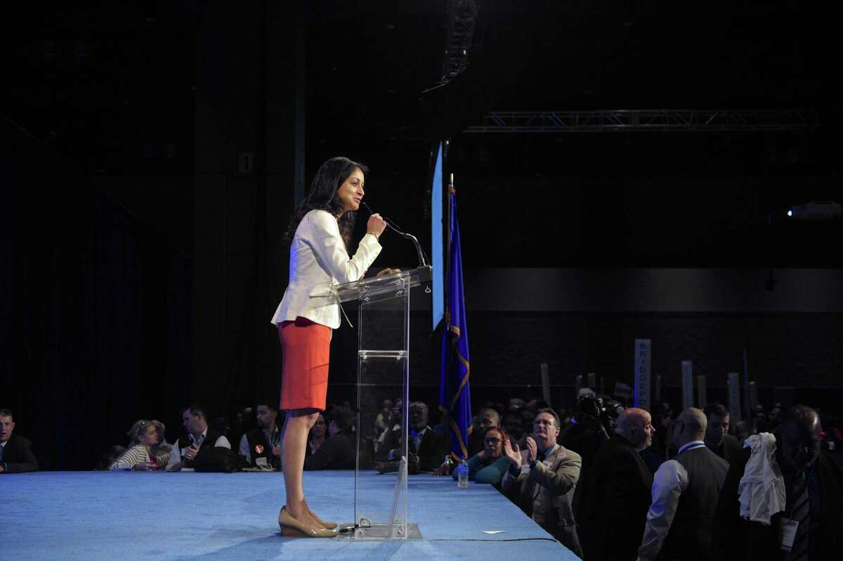 Dita Bharagava, of Greenwich, removes her name before the second ballot for State Treasure during the 2018 Connecticut democratic State Convention, Saturday May 19, 2018, in Hartford, Conn.
